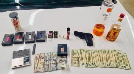 Suspect Arrested With Gun/Drugs/Cash